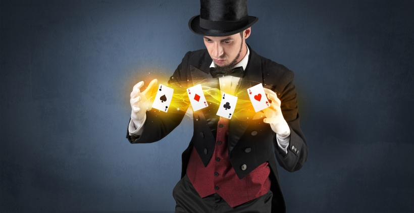 Illusionist making trick with magical play cards
